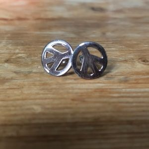 NWOT peace sign earrings never been worn